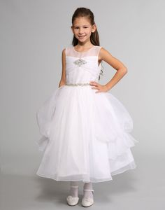 This stunning dress by Sweetie Pie Collection is a gown inspired by the bridal industry. The bodice features a satin construction with an illusion neckline. White Flower Girl Dresses, Organza Dress, Illusion Neckline, Stunning Dresses, Bodice, Satin, Gowns, Bridal, Communion