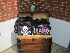 Pink Pirate Treasure Chest filled with booty for each guest:  bandana, eye patch, treat bag, sword, compass, telescope, and treasure map