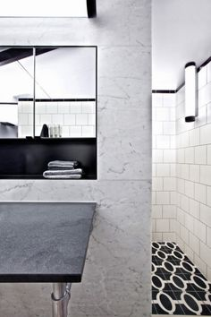 Warehouse Style Bachelor Pad - combination of white tiles, marble and black details