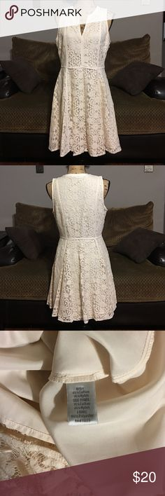 """Lauren Conrad Dress Beautiful sleeveless Lauren Conrad lace dress in a cream color. Fully lined. Side zipper. Size 12, measures 19"""" armpit to armpit and 34"""" long from shoulder to bottom LC Lauren Conrad Dresses"""