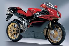 Massimo Tamburini, designer of the Ducati 916 and MV Agusta F4 (pictured), has just passed away at the age of 71. The sad news got me wondering why so few modern-day sportbikes are 'beautiful': In the quest to make something that looks 'different' and 'new,' designers seem to have forgotten the basic tenets of simplicity and harmony. So RIP Signore Tamburini. Here's hoping that your modern-day contemporaries take a quiet moment to examine your legacy, and learn something from it.