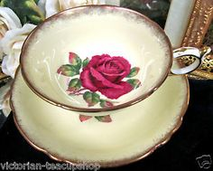 Paragon Tea Cup and Saucer Yellow with Floating Red Rose Teacup