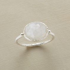 SILVER LINING MOONSTONE RING -- This silver lining moonstone ring is a portrait of rainbow moonstone's clear-to-cloudy landscape. Textured rim and band