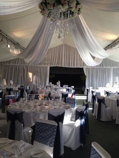 Coverit covers, ceiling canopy & flower ring.. Flowers by TJ at Designer Weddings