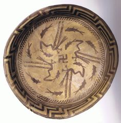 One the earliest forms of the swastika was on this plate from Samarra, Iraq (north of Baghdad), dated to about 5000 BCE. Some theorize it represents the Milky Way spiral.