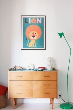 Simple but chic mid century modern dresser for a children's room. Love the tapered legs on it; it'd be even better with a dark stain and glossy white drawers
