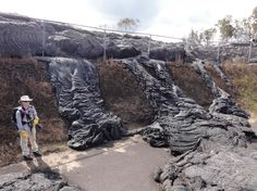 2014: The Year in Volcanic Activity - In Focus - The Atlantic  Lava flow from the Kilauea Volcano passes through a fence to the Pahoa transfer station in Pahoa, Hawaii, on November 16, 2014. (AP Photo/U.S. Geological Survey)