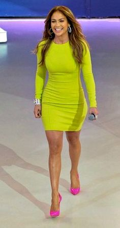 Jennifer Lopez in neon yellow dress and neon pink shoes