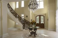Two Story Foyer Decorating Ideas Home Design Decorating With Black Color Palette And Schemes On Outstanding Large Foyer Wall Decor Striped Them House Design, Foyer Design, Entry Foyer, Iron Staircase, Basement Decor, Foyer Decorating, Basement Flooring Options, Flooring Options, Best Flooring