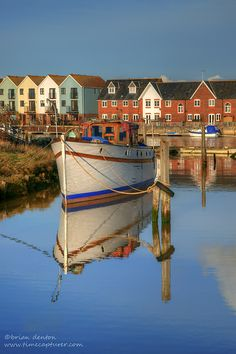 Little cabin cruiser being renovated in de shipyard on de River Arun in Littlehampton, West Sussex_ England