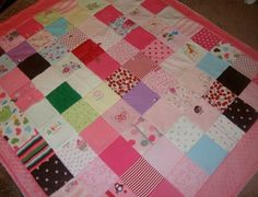 I think I want one of these...all my favorite baby clothes made into one sweet blanket.