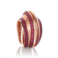 SPIRA DEMI-PAVÉ RING  ROSE GOLD & RUBY £4,800 Spira collection ring in 18k gold. Shown with 4.4ct Ruby.