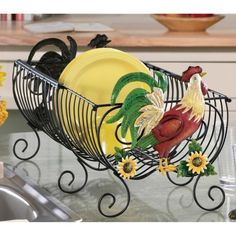 Rooster Decor under $25.00! For some odd reason i love rooster in kitchens...i think its because it reminds me of home and when i woudl psend the night at my nanas and poppas and we would cook in their kitchen with roosters everywhere :)