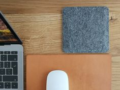 100% Pure Wool Felt desk coaster in colour Dark Grey. Minimally designed with a 2mm natural cork base that will cushion as well as protect your workspace surfaces. Beautiful 100% Pure Wool Felt upper layer that looks and feels great and a centre padding to keep them sturdy.