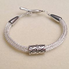 Silver viking knit woven chain bracelet with slider bead