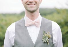 Blush pink bow tie, gray vest, and succulent boutonniere - love this look. See more from this rustic barn wedding in Nashville at Lilac Farms at Arrington Vineyards! Pics: Ulmer Studios | The Pink Bride www.thepinkbride.com