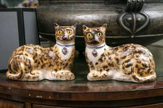 Pair of Staffordshire Pottery Cats | From a unique collection of antique and modern figurines at https://www.1stdibs.com/furniture/dining-entertaining/figurines/
