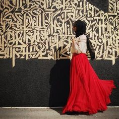 Make a statement in a full red skirt