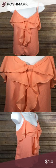 🍍Lipstick Peach Chiffon Ruffled Bow Tank Top, S 🍍Half Price Sale!!  Offer half of asking price for discount🍍.                Lipstick Chiffon Tank Top Ruffled Front Bow Bow V-Neck Adjustable Spaghetti Strapped Color:  Peach, Coral Size:  Medium Approximate Bottom Strap to Bottom Hem Measurements:  22 inches Approximate Arm to Arm Measurements:  15 inches Excellent Used Condition Lipstick Tops Tank Tops
