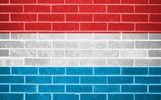flag of luxembourg on brick wall background