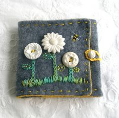 flower button needlecase. Something like this would be a good beginning to bigger articles.