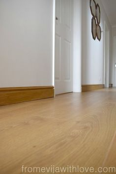 DIY - hallway makeover, light oak flooring, painted walls. full reveal on wooden flooring, woodstain, gallery wall.  Dream Home- Hallway Makeover - From Evija with Love