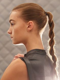 Rope ponytail - Public School runway show 2016 -After throwing hair into a classic ponytail and prepping the tail with Aveda Smooth Infusion Nourishing Style Creme, he split the tail into two equal sections and began to twist each section clockwise. When the ponytail was fully twisted to the ends, Ruiz then twisted the two sections together counterclockwise. To finish, he secured the twists with an elastic and blasted it with hair spray.