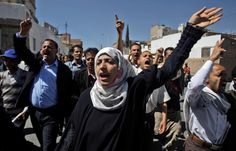 """Yemeni activist Tawakkol Karman (1979 - ) center, and other demonstrators chant anti-government slogans during a protest in Sanaa, Yemen, Saturday, January 29, 2011.   In 2011, Tawakkul was the first woman from Yemen to win the Nobel Prize for Peace """"for their non-violent struggle for the safety of women and for women's rights to full participation in peace-building work.""""  Photo credit: Hani Mohammed / AP"""