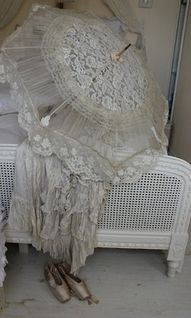 We have a lovely lace parasol that has been in the family for a couple of generations.......