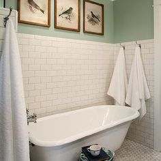 white subway tile, hexagonal marble floor, claw foot tub, placement of towel hooks