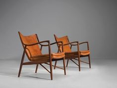 For Sale on - Finn Juhl for Niels Vodder, pair of rosewood and cognac leather, Denmark, design production This set of early chairs by Finn