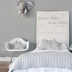 That adorable stuffed animal elephant head mounted on the wall!!! OMG! You could do that with just about any animal!! Yes!!   www.facebook.com/LFFdesigns
