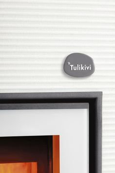 Tulikivi Hiisi soapstone fireplace here with white coating.