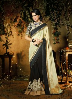 Awesome black and cream color lehenga saree with heavy butta work makes the saree remarkable for you and the blouse with heavy embroidery work makes you preety different.