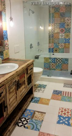 "Villa Lagoon Tile's ""Patchwork Color"" cement tile mixed with solid cement tile to create a really festive bathroom."