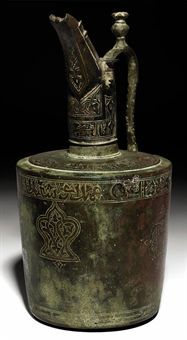 A KHORASSAN COPPER INLAID BRONZE EWER, SIGNED BY ABU SA'ID, NORTH-EAST IRAN, 12TH CENTURY