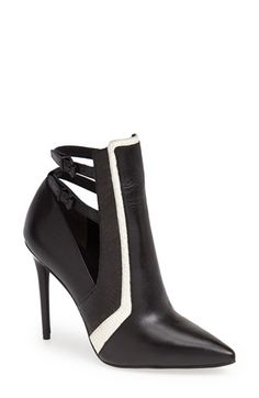 Kenneth Cole New York 'Waylan' Pointy Toe Bootie (Women) at Nordstrom.com. Genuine snakeskin adds exotic dimension to a wickedly sinuous bootie with color-blocked details and sultry cutouts. The skinny, leg-enhancing heel takes this trend-worthy look to new heights.