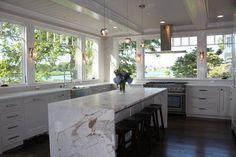 Killer kitchen windows and marble waterfall island