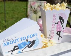 About to Pop Popcorn Boxes: Keep in theme with a Shes About to Pop! shower by sending friends and family off with a stash of popcorn — in a personalized favor box ($40/30). These movie theater-inspired containers by 6 Elm Designs feature the silhouettes of stylish moms-to-be, and are available in pink and/or blue.