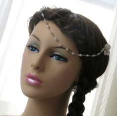 Hey, I found this really awesome Etsy listing at http://www.etsy.com/listing/158852922/white-pearls-head-hair-chain-pearls