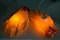 drill a small hole in the palm of the dollar store severed hand, stick an LED candle it in and you have a glowing severed hand!