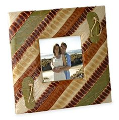 """Handcrafted Bamboo Fiber Photo Frame Size: 6.5"""" x 6.5"""" Give that someone special in your life a wonderful reminder of your times together, or a special memory of your big day with our handcrafted Wedding By The Sea Beach Leaf Picture Frame. These gorgeous frames are constructed by hand by skilled artisans from leaves found in the South Pacific. Small leaf and twine flip flops on the frame add a special flare to and already fantastic frame. Give as a gift to a loved one, a favor for…"""