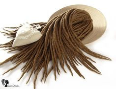 Wool dreadlocks  Tone Cinnamon  DE  Type: Double Ended Material: Worsted wool Method: Felted, handmade Pieces in set: Choose the quantity in the listing options Lenght: 30-40 inch (80-100cm) - 15-20inch (40-50cm) folded in half Thickness: 0.39-0.79 inch (1-2cm) Color: light brown  Quantity: If you have a mohawk - 30 pieces will be enough If you have a thin hair - 40 pieces will be enough If you have a tchick hair - you need 50-60 pieces   Wool dreadlocks have many advantages:  * Light –…