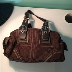 Authentic Brown Coach Purse Slightly used but in very good condition. Medium size but more small than large. Coach Bags Mini Bags