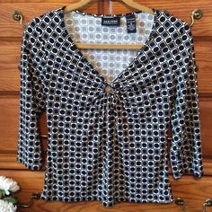 New York & Co Geo Black Top Maybe worn twice.  Classic black and white blouse with a peep hole at the bottom of the neck line. 100% polyester.  This to me is definitely on the small side of a medium or big side of a small! New York & Company Tops Blouses