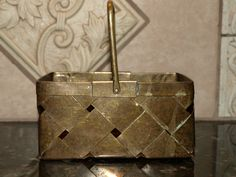 Brass Woven Basket with Handle by reneed8383 on Etsy https://www.etsy.com/listing/118669051/brass-woven-basket-with-handle