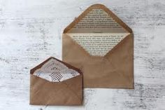 like the idea of using a book page or just pretty paper inside the envelope ; )