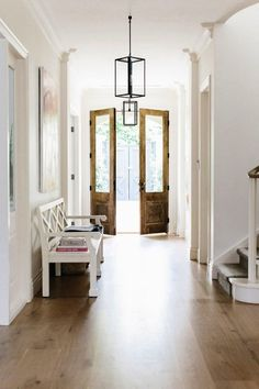 Light fixture- Entry hall to modern farmhouse, double front wood doors, chippendale bench, white, wood flooring. Style At Home, Design Entrée, House Design, Design Ideas, Lobby Design, Light Design, Graphic Design, White Rooms, White Walls
