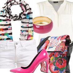 Un abbigliamento esuberante ed estroso per trascorrere una serata folle nel centro di Ibiza! I colori sgargianti e allegri degli accessori uniti al completo di pantaloncini e camicetta total white creano un mix perfetto per non passare decisamente inosservate!