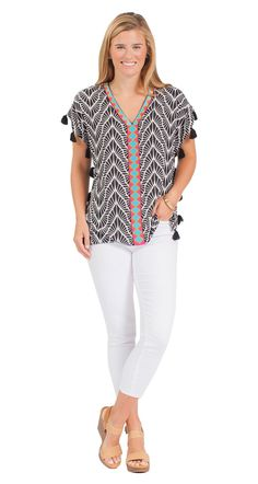 Short sleeve styling with tassel detail V-neck with embroidered placket High-low hem
